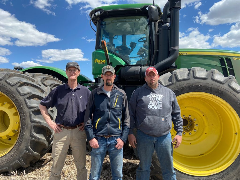 Bill Edwards (left) with his son, Ty (center), and farmhand Hunter Barnett (right) all contribute to the improvement of the Edwards farm.