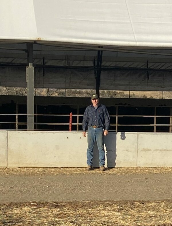 Chad Kehn in front of his cattle operation